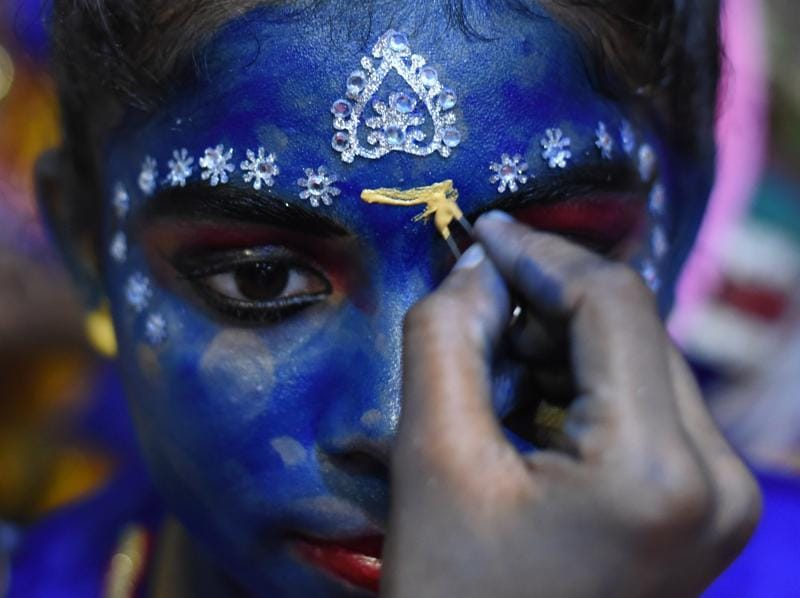 A college student dressed as Lord Krishna during a cultural event in the run up to the 'Dahi-Handi' (curd pot) ritual of the Janmashtami festival, at SNDT College, Matunga, Mumbai.  (Kunal Patil/HT PHOTO)