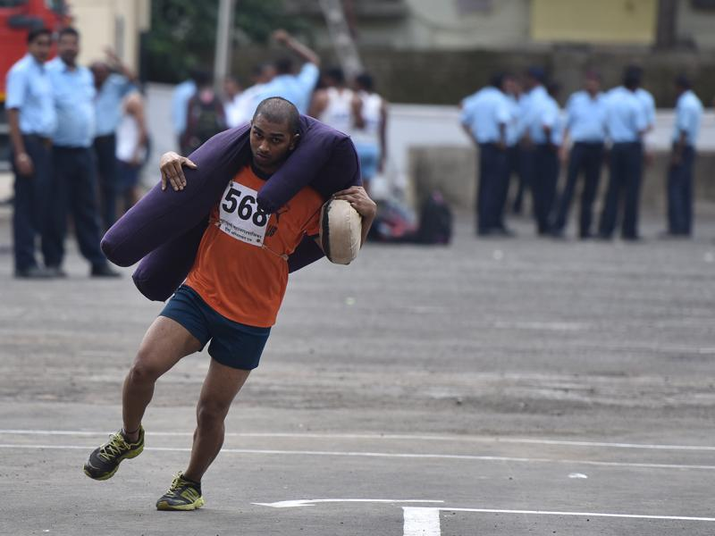 A man runs as he carries dummy of a person of 60 kg during rescue exercise at Fire Brigade recruitment drive at Borivali. Candidates have run for 60 meters with the dummy and the person who completes the task in 20 seconds, gets full marks. The candidates go through various physical tests during recruitment and get selected for training after the result of recruitment drive. After training for 6 months, 774 posts of firemen will get fulfilled through merit.  (Pratham Gokhale)