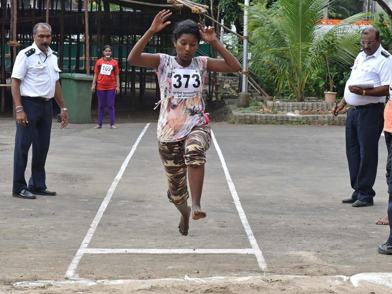 A girl jumps during long jump event at Fire Brigade recruitment drive at Borivali. Candidates go through various physical tests during recruitment and get selected for training after the result of recruitment drive. After training for 6 months, 774 posts of firemen will get fulfilled through merit.  (Pratham Gokhale)