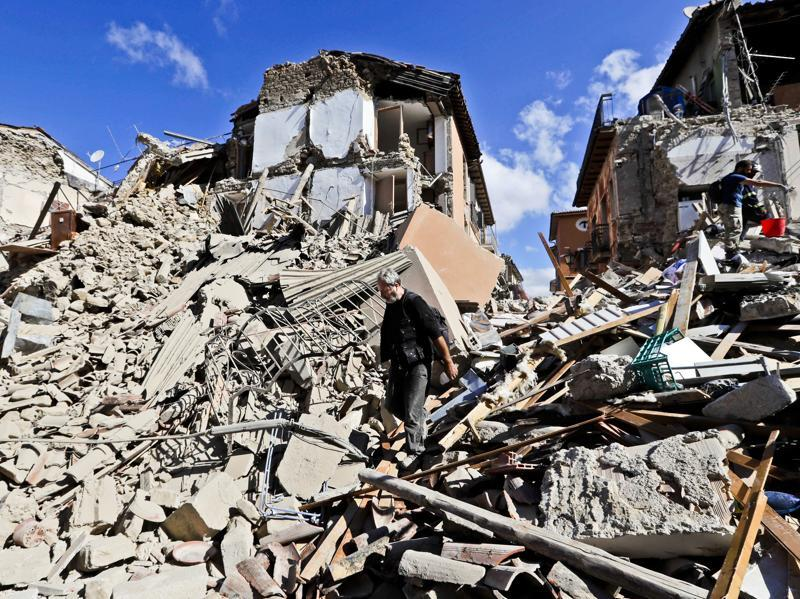 A man walks amid rubbles after an earthquake struck in Amatrice. (AP Photo)
