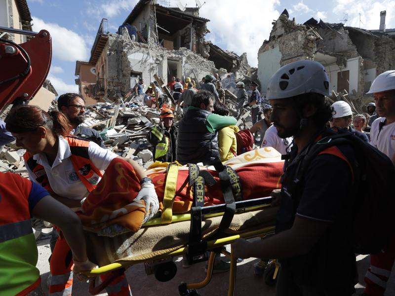 A victim is pulled out of the rubble following an earthquake in Amatrice. (AP Photo)