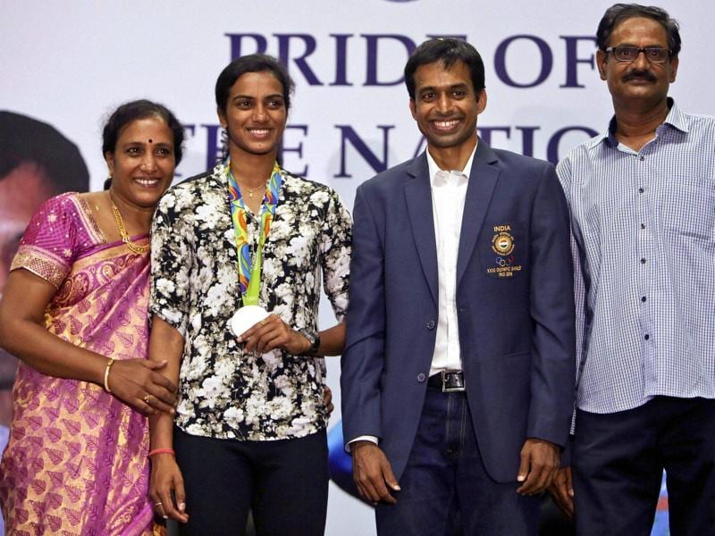 Sindhu, Gopichand, her mother P Vijaya and father PV Ramana during a reception at the Gopichand Academy in Hyderabad. (PTI)