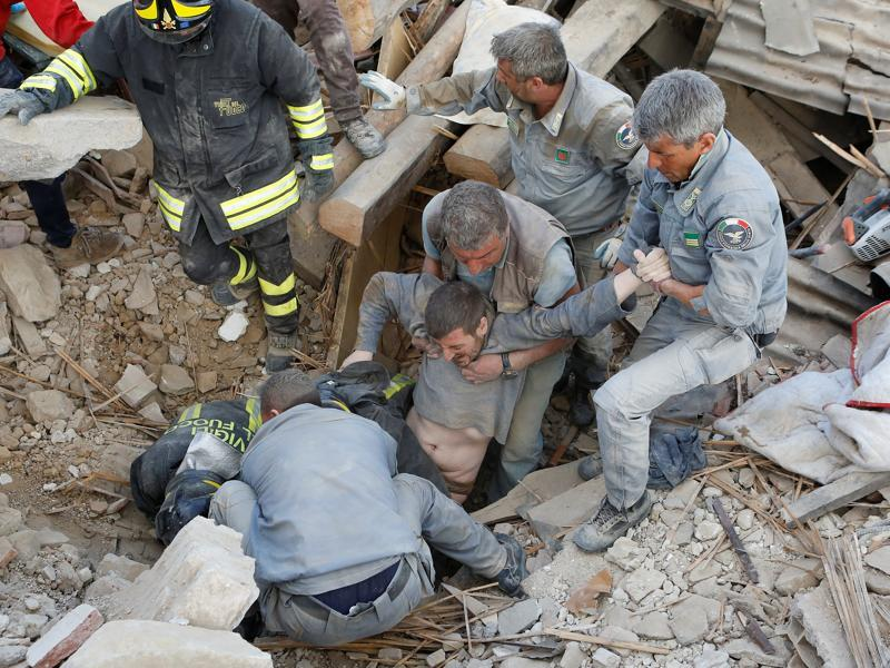 A man is rescued alive from the ruins following an earthquake in Amatrice. (REUTERS)