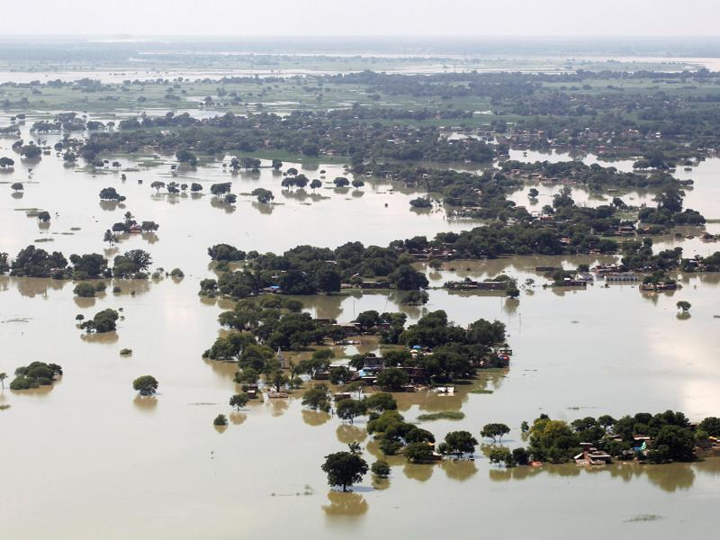 Over a 100 people have been killed and lakhs are homeless as floods continue to ravage Uttar Pradesh and Bihar. This picture shows an aerial view of a flooded village on the outskirts of Allahabad.  (REUTERS/Jitendra Prakash)