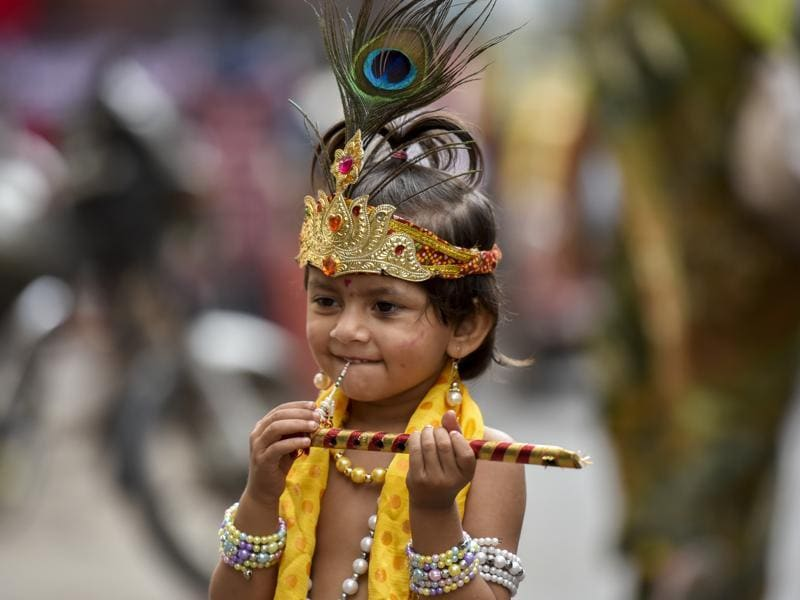 A child dressed as Lord Krishna during the Gopal Kala celebrations at Dadar on Thursday. (Kunal patil/HT )