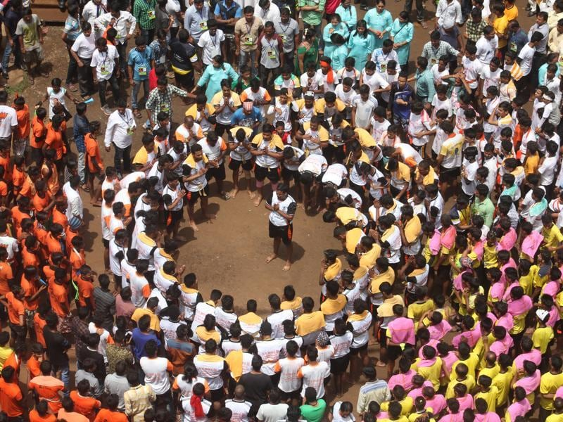 Govindas form a human pyramid at the Bhagwati School ground in Thane on Thursday. (praful gangurde/ht)