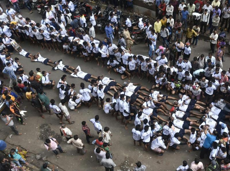 Govindas of the Kokan Nagar Govinda Pathak lie down, forming a 9-tier pyramid in protest against the Supreme Court order to restrict the height of pyramids to 20feet, at Dadar on Thursday.  (Kunal Patil/ht)