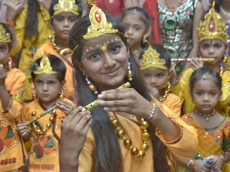 A girl among kids dressed as Lord Krishna at Child Care Public School, Amritsar, on Wednesday. (sameer Sehgal/HT Photo)
