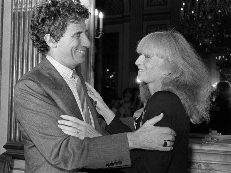 This file photo taken on September 30, 1985 shows French fashion designer Sonia Rykiel smiles as French Minister of Culture Jack Lang (L) awards her Commandeur des Arts et des Lettres, in Paris on September 30, 1985.  (AFP)