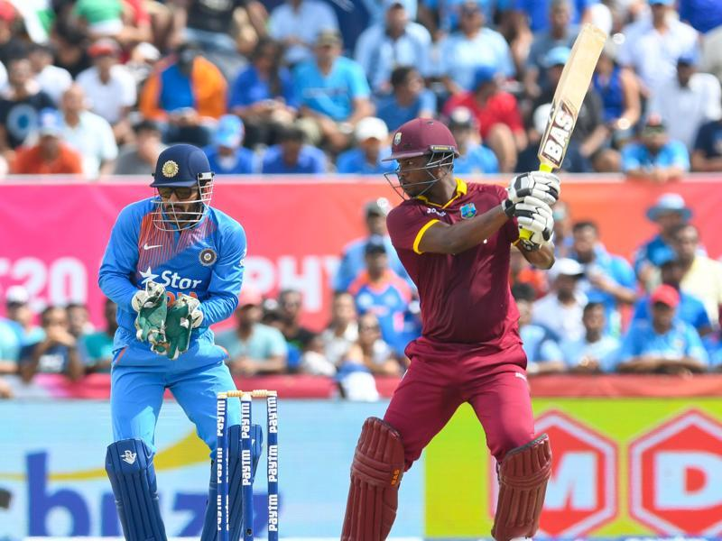 Johnson Charles (R) of West Indies hits a six. (AFP Photo)