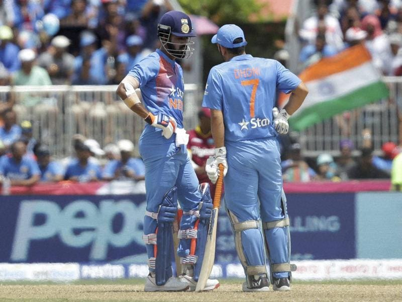 India's Lokesh Rahul, left, and MS Dhoni (7) talks in between overs. (AP Photo)