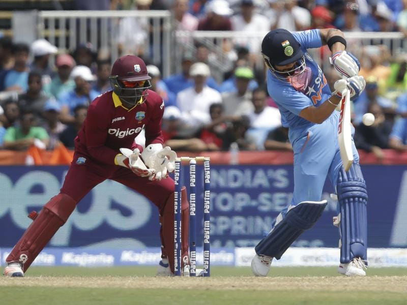 India's Virat Kohli, right, plays a shot as West Indies' Andre Fletcher looks on. (AP Photo)