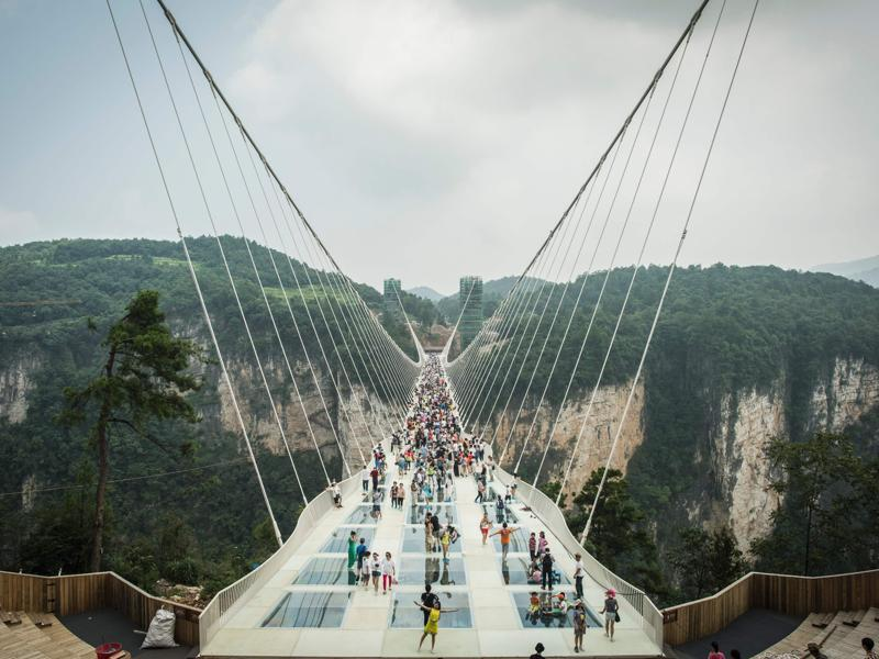 Designed by Israeli architect Haim Dotan,  the bridge spans six metres in width and is made of some 99 panels of clear glass, with a capacity to carry up to 800 people at the same time. (AFP)