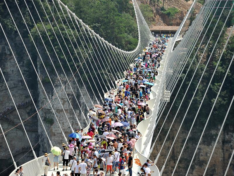 Only 8,000 people each day will be allowed to cross the bridge, according to Chinese media reports , and tourists will have to book their tickets a day in advance, at a cost of 138 yuan ($20). (REUTERS)