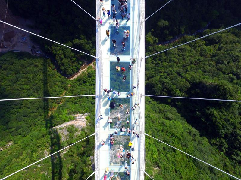 A glass-floor suspension bridge in Zhangjiajie in southern China's Hunan Province opened to the public on a trial basis recently.  (AP)