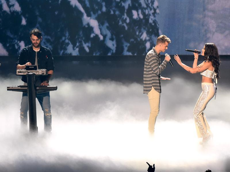 Alex Pall, left, and Andrew Taggart of The Chainsmokers, perform with Halsey at the MTV Video Music Awards at Madison Square Garden. (Charles Sykes/Invision/AP)