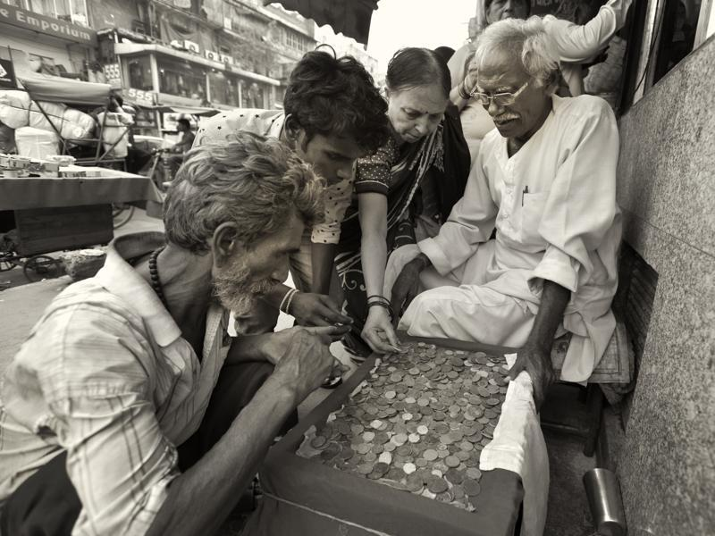 Chandni Chowk in Old Delhi is crowded, chaotic and filled with history . It's a tourist attraction and for coin collectors  a Mecca . Antique coin seller Sukh Ram Tiwari, 74, has been serving collectors in Chandni Chowk for the last four decades. Tiwari earns about Rs 200 everyday by selling coins. (Virendra Singh Gosain/HT PHOTO)