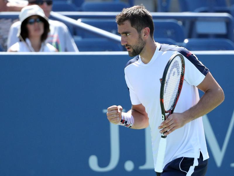 Marin Cilic of Croatia reacts to a break point against Roger Dutra Silva of Brazil. (AFP Photo)
