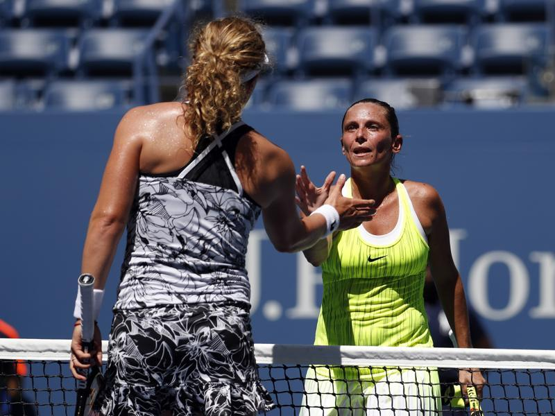Roberta Vinci, of Italy, right, greets Anna-Lena Friedsam, of Germany, after winning their first round match. (AP Photo)