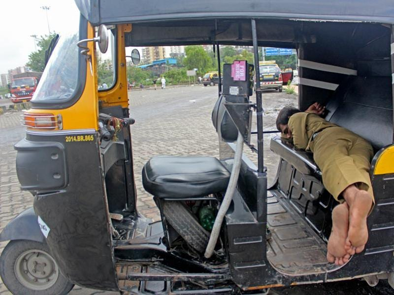 An auto rickshaw driver sleeps away at Lokmanya Tilak Terminus for Wednesday was no-duty day for him. (Satyabrata Tripathy/ht photo)