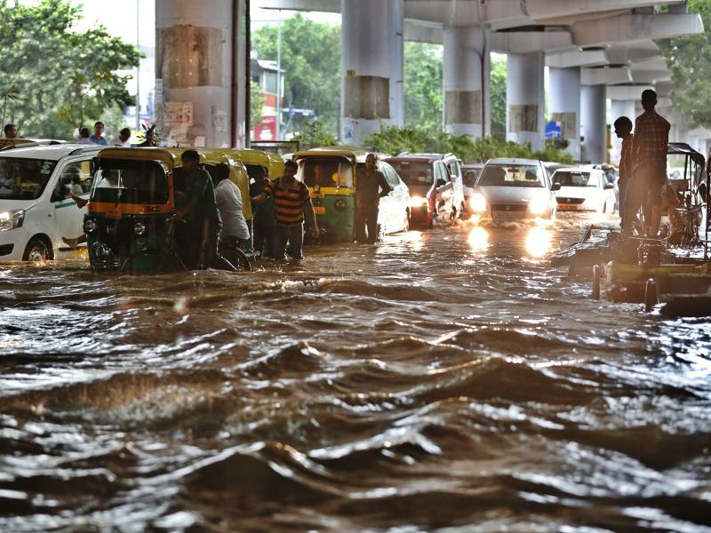 Heavy rainfall flooded Patel Nagar and even taking shelter under a flyover was no help. (Sanchit Khanna/HT Photo)