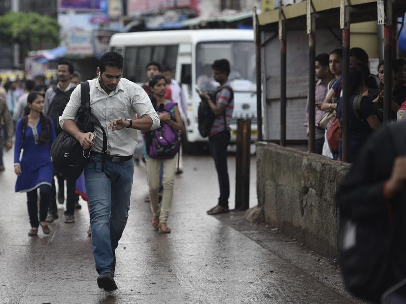 A man runs to catch BEST bus outside Kurlla station (West) as auto rickshaws in the city go off roads in protest against app-based cabs on Wednesday.  (Arijit Sen/ht photo)