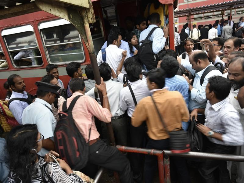 Although the transport department directed MSRTC to operate more buses, but rush due to the strike was huge. People struggle to board a bus at Kurla station. (Arijit Sen/ht photo)
