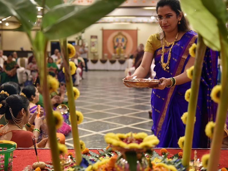A newly wed woman performs the Mangala Gauri puja at Borivli on Sunday. The vrat is observed on every Tuesday of the Hindu month of Shravan and is dedicated to Goddess Parvati. Newly wed women fast through the day and perform an arti in the evening with other women from the family and neighbourhood. Traditionally, after the puja, women perform mangalagauriche khel -- which involves singing, dancing, physical activities and games such as jhimma and fugadi. (Pratham Gokhale/HT PHOTO)