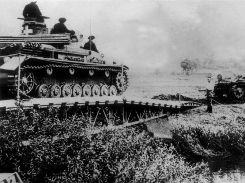 Germans tanks cross a river into Polish territory, in September 1939.