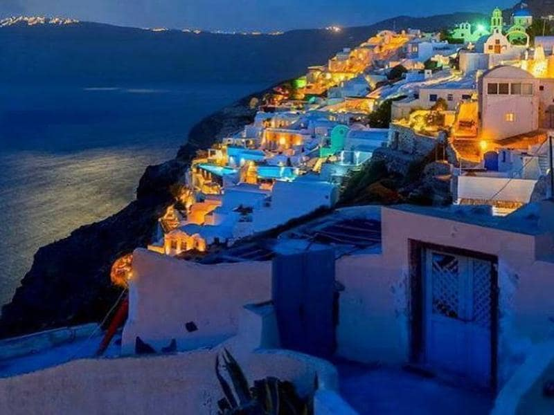 The ongoing migrant and economic crises in Greece have done little to deter visitors from descending on the Mediterranean paradise. Santorini by the night... (webgreece/instagram)