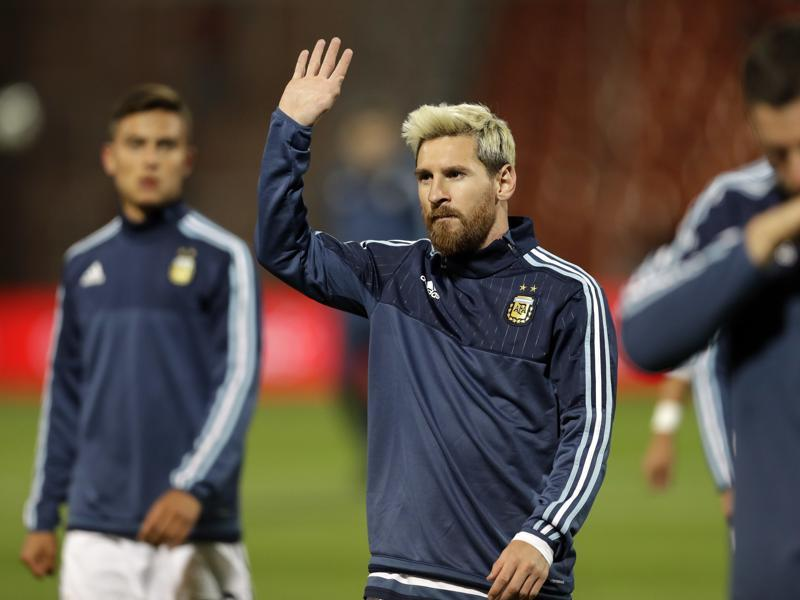 Argentina's Lionel Messi, center, waves to fans. (AP Photo)