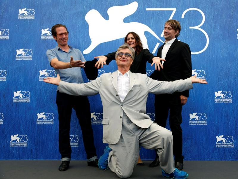 Director Win Wenders (C) poses with actors Reda Kateb (L), Sophie Semin and Jens Harzer (R) as they attend the photocall for the movie Les Beaux Jours d'Aranjuez (The Beautiful Days of Aranjuez) at the 73rd Venice Film Festival in Venice, Italy. (REUTERS)