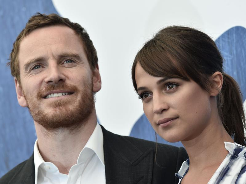 Irish actor Michael Fassbender and Swedish actress Alicia Vikander pose during a photocall of the movie The Light Between Oceans presented in competition at the 73rd Venice Film Festival. (AFP)
