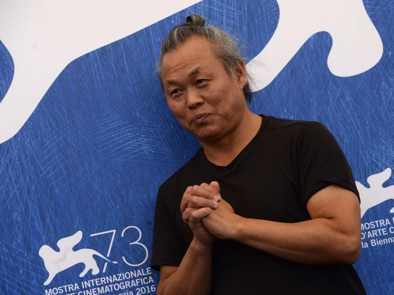 Director Kim Ki-duk poses during a photocall of the movie Geumul (The Net) presented out of competition at the 73rd Venice Film Festival. (AFP)