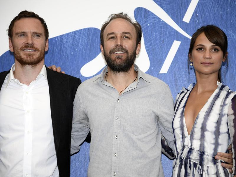 From left, actor Michael Fassbender, director Derek Cianfrance, and actress Alicia Vikander attend a photo call for the movie The Light Between Oceans. (AP)