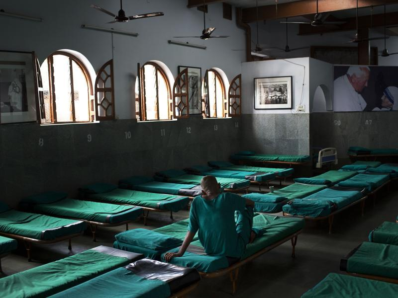 An inmate sits on his bed at Nirmal Hriday, Kalighat, Mother Teresa's home for the dying and destitute in Kolkata.  (AP)