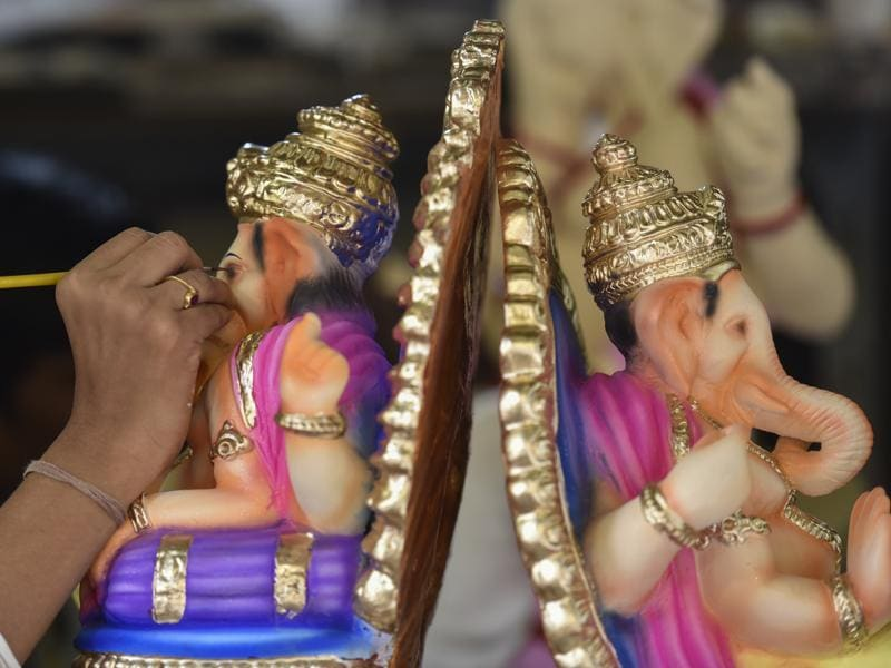 KING OF GODS: An artist works on Ganpati idols. (Kunal Patil/ht )