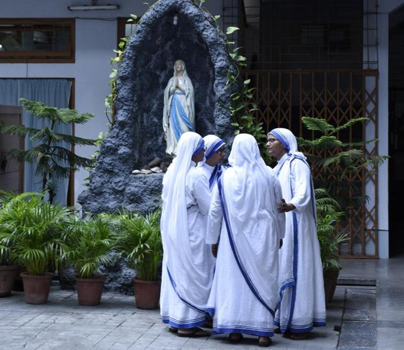 Nuns discuss daily matters in the courtyard of the Mother House in Kolkata.  (Samir Jana/HT PHOTO)