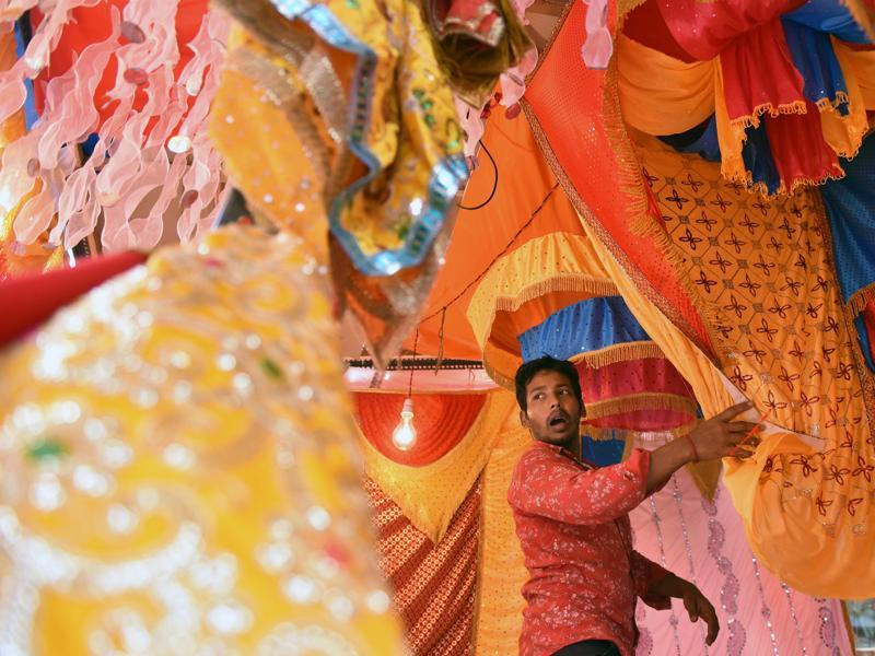 FESTIVAL OF JOY: A vendor sells colourful cloths, which will be placed on Ganpati idols,  at Dadar. (Pratham Gokhale/HT)