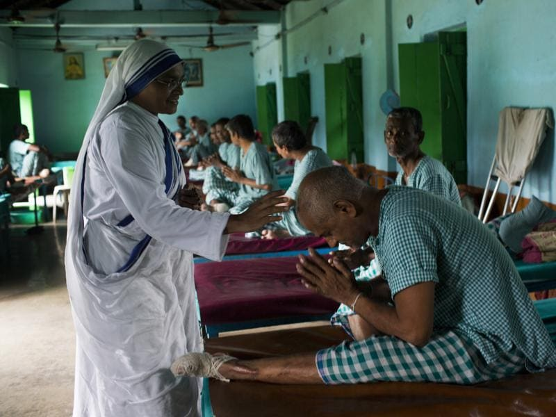 A patient pays respect to a nun at the Gandhiji Prem Nivas, a leprosy centre conducted by Missionaries of Charity in Titagarh, north of Kolkata.   (AP)