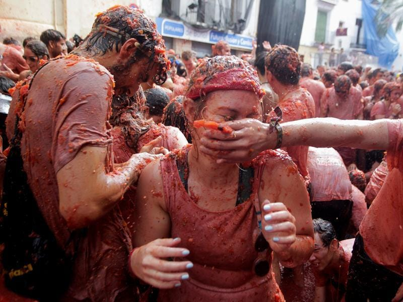 Since 1945, it has been held on the last Wednesday of August, during a week of festivities. Revellers battle with tomato pulp. (REUTERS)