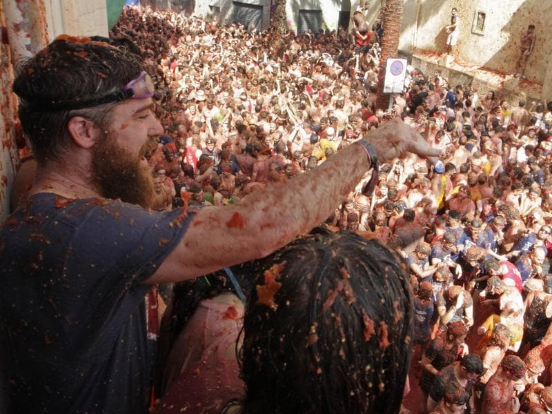 The festival involves throwing and pelting tomatoes as part of a fun fight. It is played purely for entertainment purpose. Revelers make merry... Trucks dumped 160 tons of tomatoes for some 20,000 participants, many from abroad, to throw during the hour-long morning festivities. (AP)