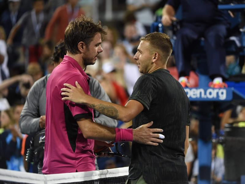 Wawrinka and Evans embrace at the net after the match. (AFP)