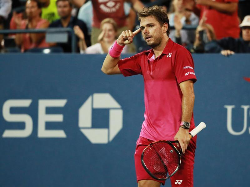 Stan Wawrinka of Switzerland reacts after winning a five-set thriller and saving match point to overcome Daniel Evans of Great Britain. (AFP)
