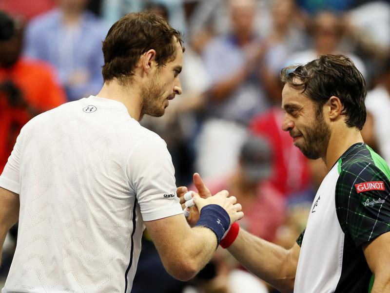 Murray and Lorenzi shake hands at the net after the match.  (AFP)