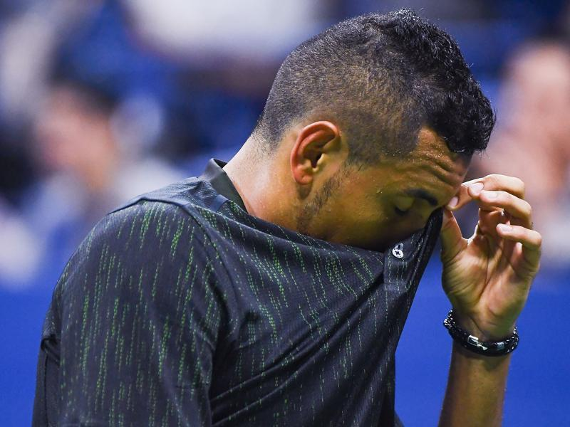 Nick Kyrgios of Australia wipes his face during his loss to Illya Marchenko of Ukraine. Trailing 6-4, 4-6, 1-6, Kyrgios retired with a hip injury. (AFP)