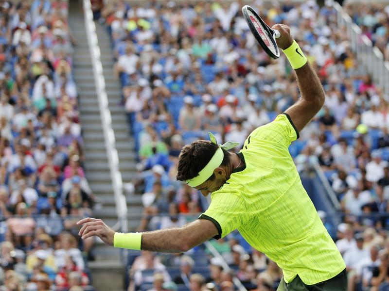 Del Potro reacts after losing a point by smashing his racket. (AP)