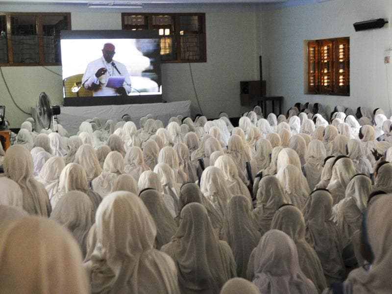 Indian nuns from the Catholic order of the Missionaries of Charity watch a live telecast of the canonisation of Mother Teresa from Rome at The Mother House in Kolkata on Sunday. (Subhankar Chakraborty/HT PHOTO)