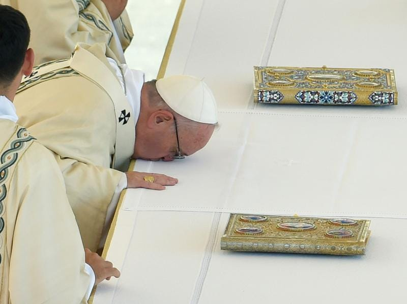 Pope Francis  prays during the canonisation of Mother Teresa. The nun's whose work with the dying and destitute of Kolkata made her a global icon of Christian charity, was made a saint on Sunday.  (ANDREAS SOLARO/AFP)