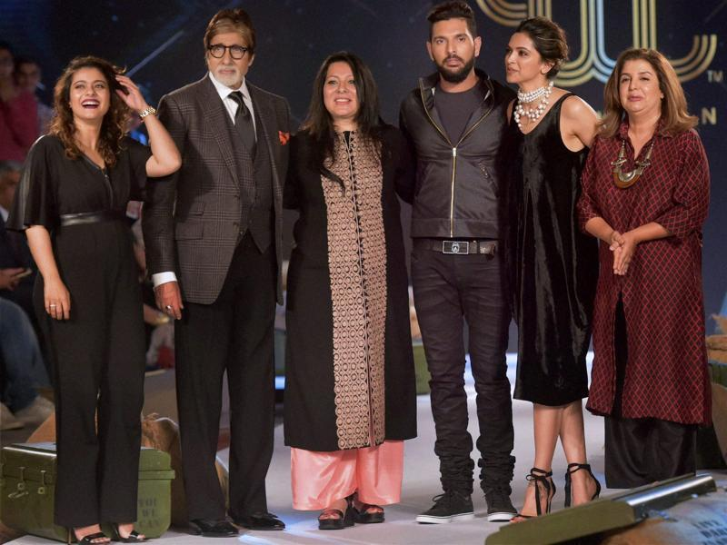 Indian cricketer Yuvraj Singh with his mother Shabnam Singh, bollywood actors Kajol, Amitabh Bachchan, Deepika Padukone and film director Farah Khan during the event to unveil Yuvraj's fashion label YWC in Mumbai. (PTI)